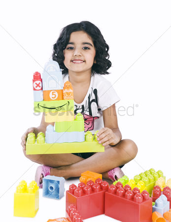Bliss : Portrait of a girl playing with building blocks