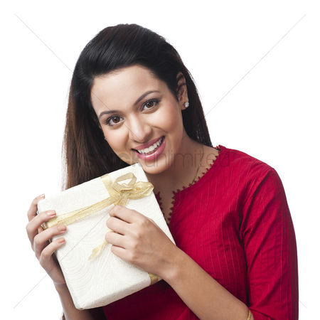 Housewife : Portrait of a happy woman holding a gift box