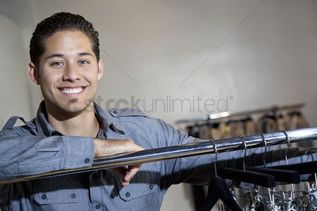 Selection : Portrait of a happy young man standing in fashion boutique