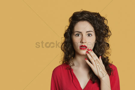 Beautiful : Portrait of a shocked woman over colored background