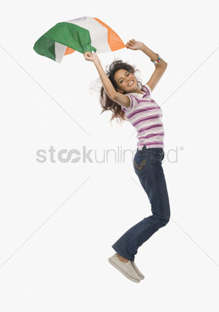 Respect : Portrait of a woman jumping with an indian flag