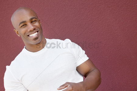 Bald : Portrait of a young muscular man over colored background