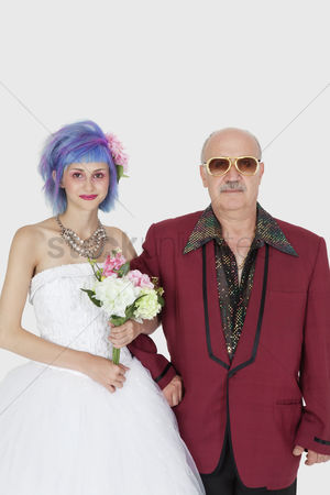 Man suit fashion : Portrait of beautiful young bride standing arm in arm with father