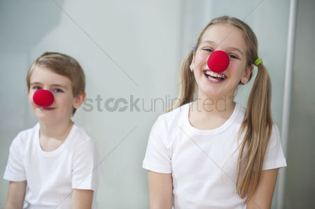 Funny : Portrait of children wearing clown noses