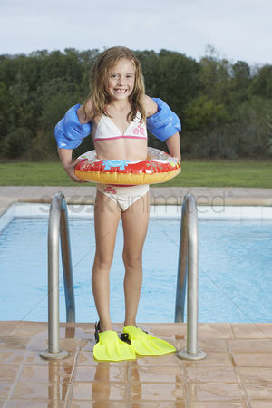 Swimmer : Portrait of girl  5-6  by pool with inflatable ring and swim fins