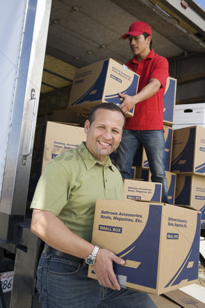 Truck : Portrait of man unloading with worker truck of cardboard boxes