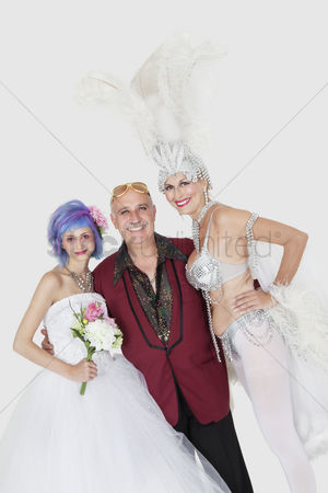 Man suit fashion : Portrait of man with senior showgirl and daughter in wedding dress over gray background