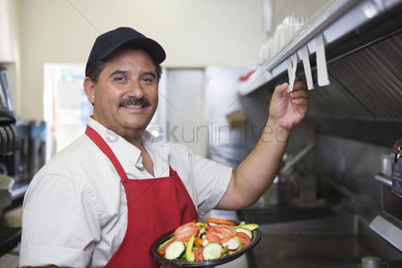 Apron : Portrait of man working in restaurant kitchen