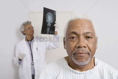 Examination : Portrait of senior man waiting for healthcare results