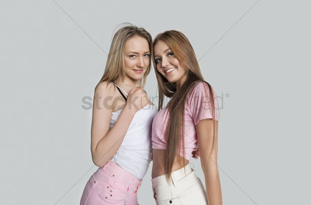Teenager : Portrait of smiling female friends against white background