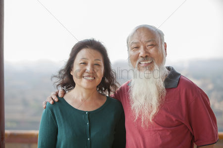 Forbidden : Portrait of smiling old couple in jing shan park
