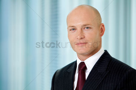 Bald : Portrait of young caucasian businessman in office