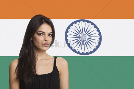 Respect : Portrait of young woman against indian flag