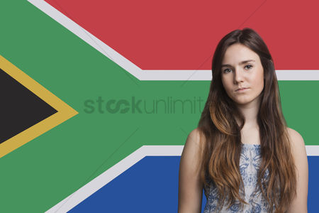 Respect : Portrait of young woman against south african flag