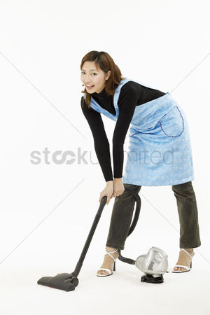 Housewife : Portrait of young woman doing cleaning