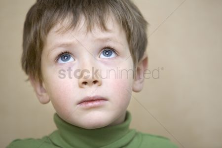 Wondering : Portrait young boy gazing upwards