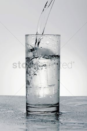 Cold : Pouring water into drinking glass with ice
