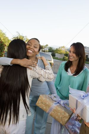 Women group outside : Pregnant asian woman embracing friend at a baby shower