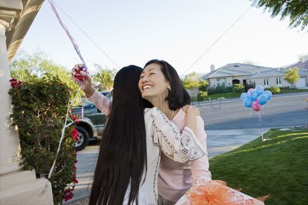 Women group outside : Pregnant asian woman embracing mother at a baby shower
