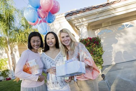 Women group outside : Pregnant asian woman with mother and friend at a baby shower