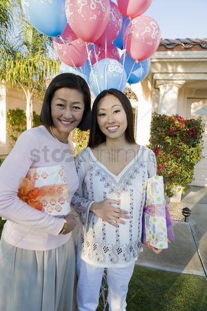 Women group outside : Pregnant asian woman with mother at a baby shower