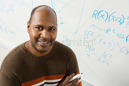 High school : Professor by whiteboard with equations  portrait