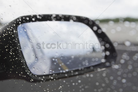 On the road : Rain drops on the side-view mirror of a car  dublin  republic of ireland