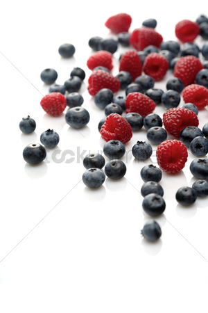Variety : Raspberries and blueberries on white background