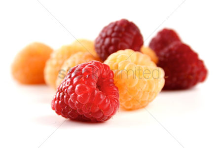 Fruit : Red and yellow raspberries on white background