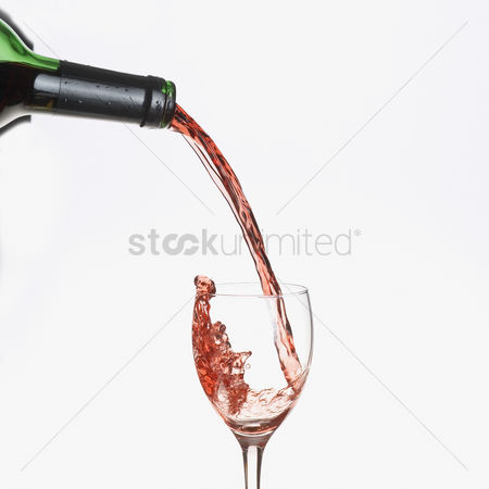 Wine bottle : Red wine pouring from a bottle into a glass