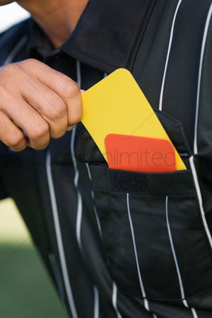 Pocket : Referee taking card from pocket mid section