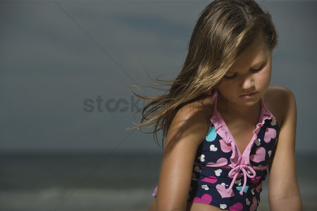 Thought : Sad little girl on a beach