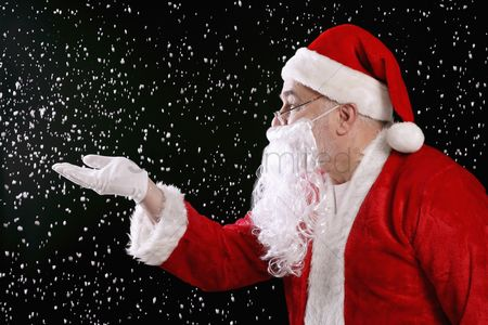 Cold temperature : Santa claus playing with snow