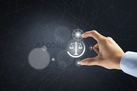 Business Finance : Scales of justice icon with hand gesture