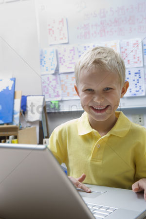 Young boy : Schoolboy using a laptop