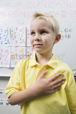 Schoolkids : Schoolboy with his hand over his heart