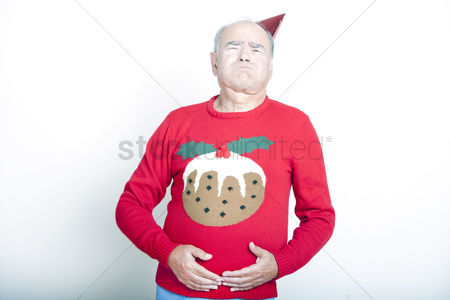 Funny : Senior adult man indicating that he is full up