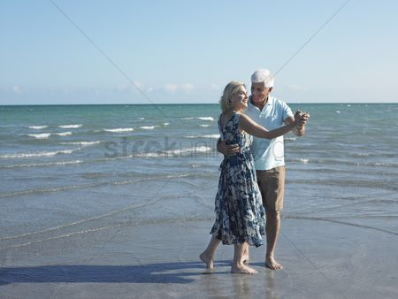 Enjoying : Senior couple dancing on beach