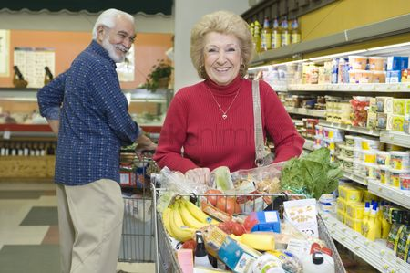 Shopping cart : Senior couple food shopping in supermarket