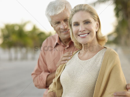 Appearance : Senior couple palm trees in background