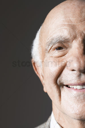 Bald : Senior man in studio close up