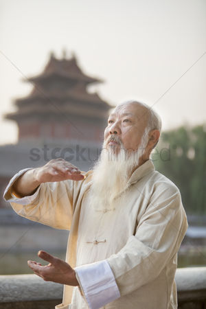 Forbidden : Senior man practicing tai ji