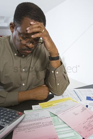 Worry : Senior man worrying about home finances