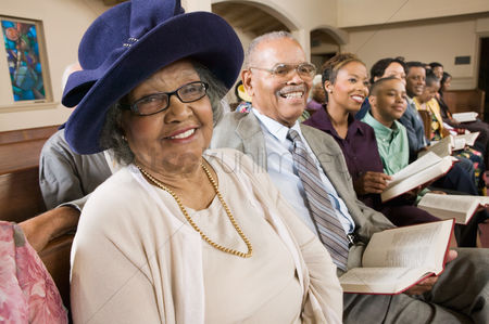 Celebration : Senior woman in sunday best among congregation at church portrait