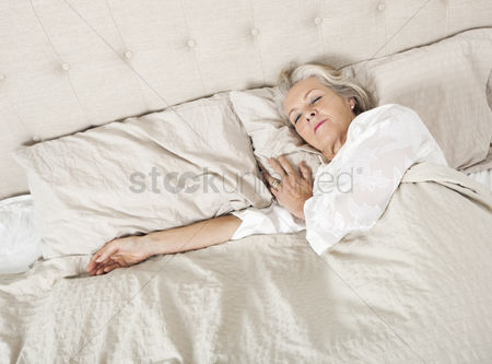 Senior women : Senior woman sleeping in bed