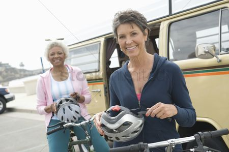 Women group outside : Senior women prepare for cycle ride