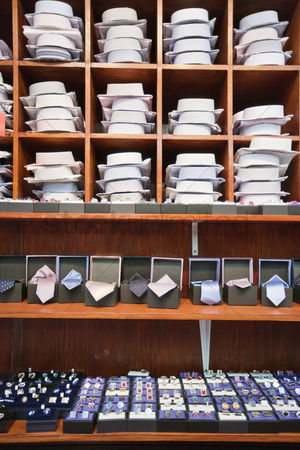 Accessories : Shirts neckties and hand cuff links displayed on shelves