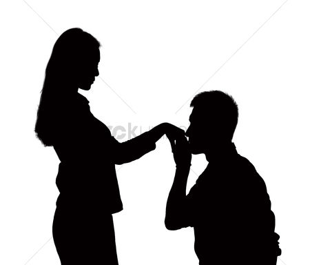 Kissing : Silhouette of man on one knee  kissing woman s hand