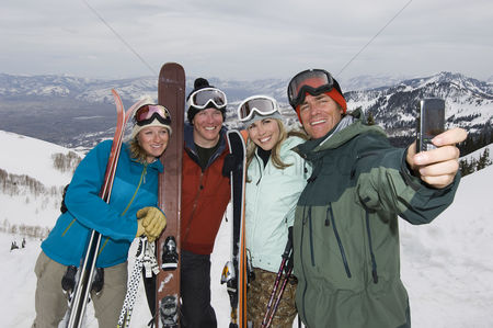 Women group outside : Skiers taking their picture with cell phone