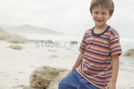 Gladness : Smiling boy on beach